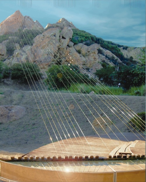"This is the Earth Harp, the world's largest stringed instrument. Invented in 1999 by artist William Close, it runs 1,000 ft. strings (about the length of 3 football fields) across a natural environment and then ""plays"" that environment.The strings are rubbed with violin bows and cotton gloves. The instrument itself is tuned to an A Minor scale.   The Earth Harp has been used to ""play"" the Seattle Space Needle, the Colosseum of Rome and The Grand Theater of Shanghai.  /Salon97 - Kevin"