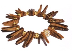 Coco Spiked Bracelet. This bracelet is edgy and earthy for a modern tribal appeal. Looks stunning stacked with other bracelets & worn two or three at a time. Content & Care: * coco tusks, metal, & crystal bead. * handmade