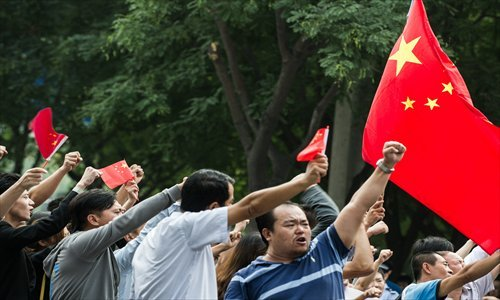 "sadowa:   Protesters gather in front of the Japanese embassy in Beijing on Tuesday. Photo: Li Hao/GT  Discard illusion of friendly ties with Japan Sino-Japanese relations suffered a serious blow Tuesday when the Japanese government signed a deal to purchase the Diaoyu Islands with the self-proclaimed ""owner."" The friendly ties between the two countries established in the 1970s collapsed completely. Chinese anger of over a century toward Japan was awakened Tuesday, and will in turn affect Japanese feelings toward China. It appears inevitable the two sides will be overwhelmed by hatred again now that more conflicts can be expected. China needs to be prepared for further deterioration of bilateral ties. For Beijing, the future priority isn't to maintain stable ties, but to protect its core interests as Sino-Japanese relations sour. Despite China's commitment to building friendly neighboring ties, the Diaoyu issue has turned China and Japan into opponents. China isn't used to having an adversary close by. But it isn't necessarily a bad thing. Japan inflicted painful atrocities against China in the past. It is now more developed than China, but is in decline. The balance of national power is shifting between the two. With such a close opponent, China can be spurred to action. Japan depends on the Chinese market more than China does on the Japanese market. A political confrontation will bring insignificant economic damage to China. Meanwhile, with China's nuclear deterrence, Japan is less likely to launch a military attack on China. Of course, Tokyo may remilitarize itself, even with nuclear armaments, encouraged by the US. But that still poses a limited threat to China. China has plenty of measures to restrain Japan. Pressure on Japan can also come from other neighboring countries. China has been advocating friendly ties with its neighbor, but Japan has created enough troubles for China over the years. But its behavior toward the US and Russia demonstrates its inferiority toward strong countries. China cannot repeat what the US and Russia did to Japan. But a lesson is necessary to dispel its contempt toward China since the Meiji Restoration. China is accumulating strength with its fast development. It can fully show this strength to Japan in a future conflict to reverse Japan's attitude toward China. Until that time, it is possible to restart friendly ties between China and Japan. It may take 30 years if it goes smoothly. In a word, most young and middle-aged people will be able to see Japan treat China differently. Keeping friendly neighboring ties is a good policy. But it cannot be achieved through one-sided begging and compromising."