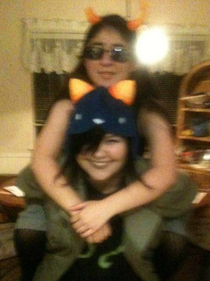 meganstopit:  a really blurry picture of me and laura as ironic equius and nepeta halloween last year, because i'm a lot taller than her hrghrhga;dksfj gomen, i'm really bad at cosplay, and i still need to fix those horns, because they're way too close together, and i'm also going to make a better hat at some point, and probably get a better jacket and a good shirt, instead of one that i painted myself haHAHALSDFkjawe;sj ;;;;; we also didn't paint, because it was just for halloween, and hrghrhg money for body paint more like no thanks  more like we both made the cosplays the day before HAHAHAyou are so cute though omfg