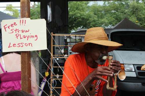 seeing-doing:  Free Straw Playing LessonBaltimore September 2012   I love this guy!