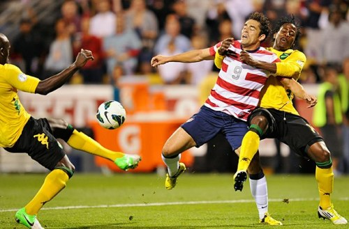 futboldaddy:  U.S beat Jamaica 1-0 thanks to Hercules' goal. Here he's bearhugged by the Timbers very own Lovel Palmer.