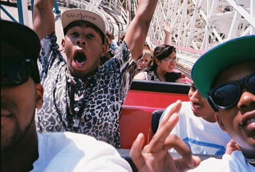 Tyler The Creator with Odd Future riding a roller coaster.
