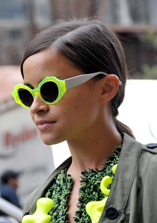 ofthemomentblog:  Miroslava Duma in bright yellow sunglasses.