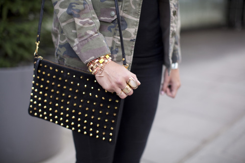 Tell me about it, stud. True fashion grunge in camo and stacked jewels.