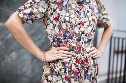 Show off a cheeky shoulder in this floral flippy dress.