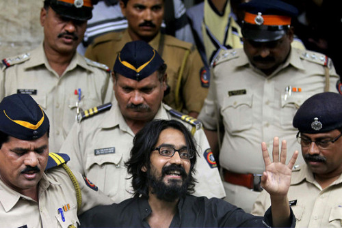"Indian Cartoonist Arrested on Sedition Charges Via the Wall Street Journal:  Cartoonist and free speech activist Aseem Trivedi was set to pick up an award for his hard-hitting cartoons in Washington D.C. this week. But his trip was abruptly canceled after a Mumbai court found the same cartoons ""offensive"" and issued a warrant for his detention. ""My cartoons did nothing but tell the truth,"" Mr. Trivedi told India Real Time on Friday after he heard of the court order. He voluntarily surrendered to police on Saturday and has been unreachable since. A local court accused Mr. Trivedi of sedition over cartoons that appear to mock the Indian state. The cartoons were on display at an anti-corruption rally last December in Mumbai."
