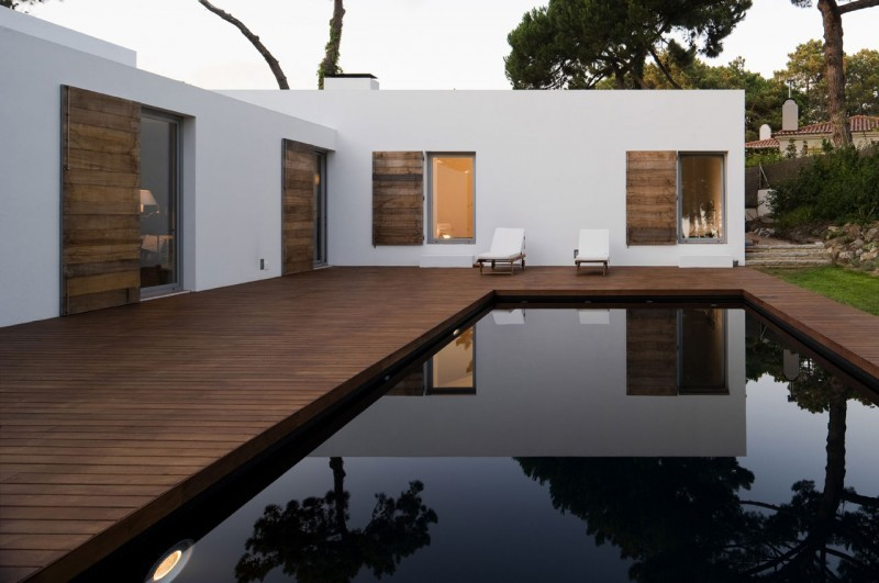 Casa no Banzão ll by Frederico Valsassina Arquitecto This beautiful, minimalistic house, designed by Frederico Valsassina, is located in the pine forest Banzão in Sintra and overlooks the mountains. Having been there a pre-structure that the clients had a connection to, the architect decided to keep the old materials and simply reuse them within the construction. This is definitely living a house the cool way.  To look at more images of the house, as well as its blue print, go to Homedsgn.