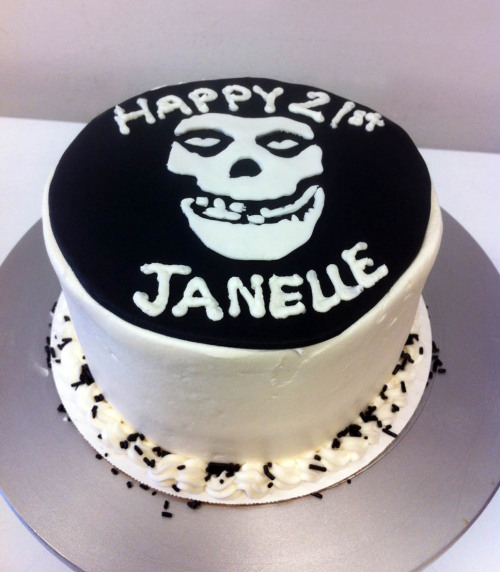 Red velvet cake with cream cheese frosting, topped with the Misfits skull logo!