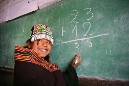 From unicef:  A smiling girl does arithmetic at the blackboard in a UNICEF-assisted local primary and secondary school in Pisili, an indigenous Ayllu Yampara settlement in the south-central department of Chuquisaca, near the town of Tarabuco, capital of Yamparáez Province in Bolivia. UNICEF supports a child-friendly education project for indigenous girls in Chuquisaca Department. © UNICEF/NYHQ2008-1573/Giacomo Pirozzi http://www.unicef.org