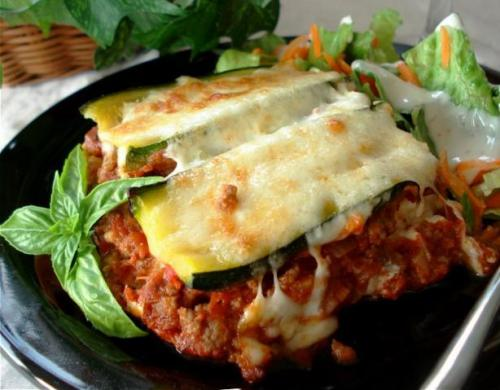 So yesterday I made zucchini lasagna with this recipe. It took 3.5 hours and the kitchen looked like a kindergarten art classroom afterwards. That all being said, it was way tasty, sort of like real ratatouille (and by that I mean the stirred, delicious French slop as opposed to the neatly layered gratin that restaurants pass off as the dish. Fakers.) meets a bolognese sauce. Of course, we didn't have mozzarella to top it with (just some fresh goat's milk ricotta for the inner layers) so I just tossed basil and olive oil on top—which wasn't the wisest idea cuz the basil just burned (LOL) and even though it was tasty when the husband came home he thought I'd charred our dinner. Anyway, the key to the dish is to KEEP THE LIQUID DOWN. Get the sucker as dry as possible. And I wished I had a good mandolin slicer because I almost lost a couple of fingers. Anyway, I salted and layered the zucchinni slices in tiers of paper towel so that they'd lose moisture. Oh, and I drained the excess liquid from the meat immediately. By the time it went in the pan, it was pitch-perfect in terms of moisture. But yeah, husband comes home and he's like—you should have cooked the zucchini separately. It would have saved you an hour. To my credit, I didn't throw anything. But yeah, next time—I will cook the zucchinni separately. Blargh.