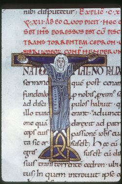 initial T - crucified woman (holding vessels or breast and vaginal symbols?) Augustine, Tractatus in Evangelium Johannis, Tours 12th century. Tours, BM, ms. 291, fol. 130v