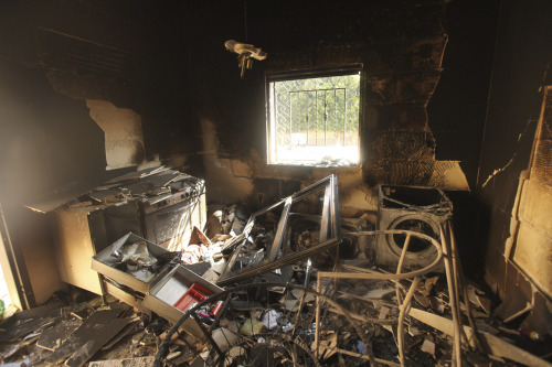 reuters:  An interior view of the damage at the U.S. consulate, which was attacked and set on fire by gunmen yesterday, in Benghazi September 12, 2012.  Christopher Stevens, the U.S. ambassador to Libya, and three embassy staff were killed as they rushed away from the consulate building, stormed by al Qaeda-linked gunmen blaming America for a film that they said insulted the Prophet Mohammad.  Stevens was trying to leave the consulate building for a safer location as part of an evacuation when gunmen launched an intense attack, apparently forcing security personnel to withdraw. [REUTERS/Esam Al-Fetori]  PHOTOS: Protesters storm U.S. consulate in Benghazi, Libya
