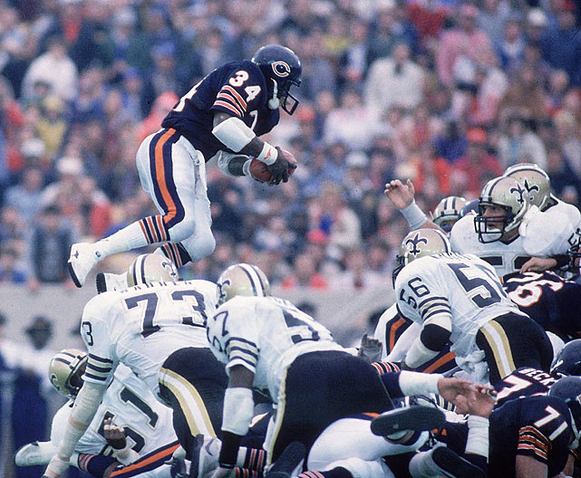 Walter Payton jumps over a pile of defenders to score a touchdown during a 1984 Bears-Saints game. Later in the game, Payton would pass Jim Brown as the NFL's all-time leading rusher. (Andy Hayt/SI) GALLERY: Rare Photos of Walter Payton | NFL's All-Time Top RBs
