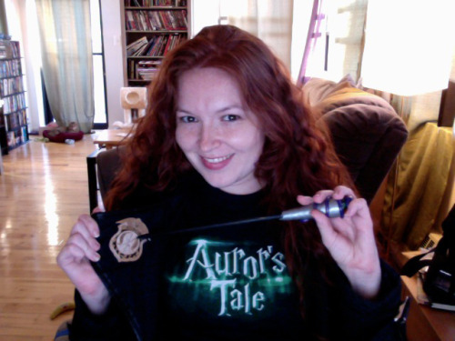 Sporting my official Auror-wear thanks to @AurorsTale! Wand is my own. (how does my cat always get in these pictures?!)