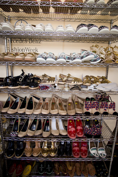 The racks of shoes, backstage at Tory Burch, spring 2013 Photo: Mark Leibowitz