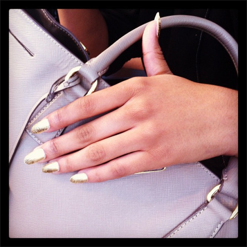 At Jeremy Scott: Dagger-like nails sheathed in goldtone decals custom made by Dashing Diva Photographed by Avery Spofford