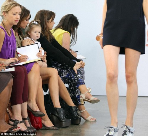 "Harper Beckham sat in the front row at the Victoria by Victoria Beckham fashion show this morning, and she did not seem impressed by what she saw. This is what I love about Harper — she is not afraid to show her emotions, for better or for worse. I myself could not attend my mother's fashion show today. I had better things to do, like ""school,"" getting my nails done, and quietly reading."