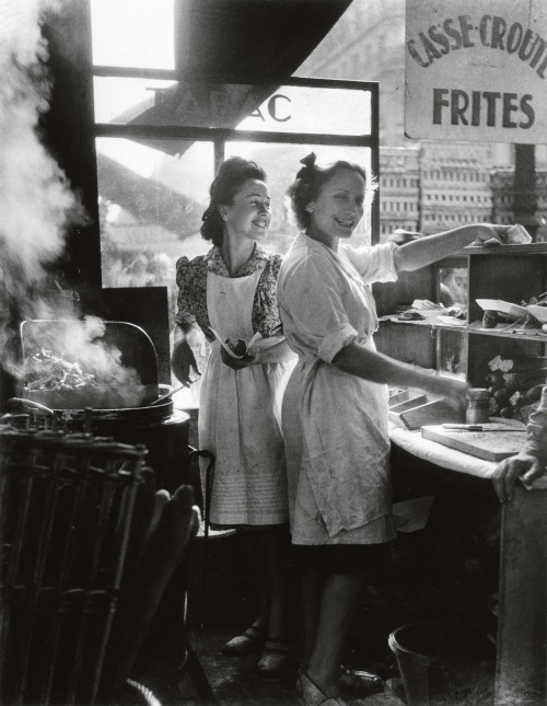 swanngalleries: The war is over! Post World War II, a couple of French gals take part in the small pleasures of life in Willy Ronis' 1946 silver print entitled Rue Rambuteau, seen in our Important Photographs & Photobooks sale from October 19, 2010.