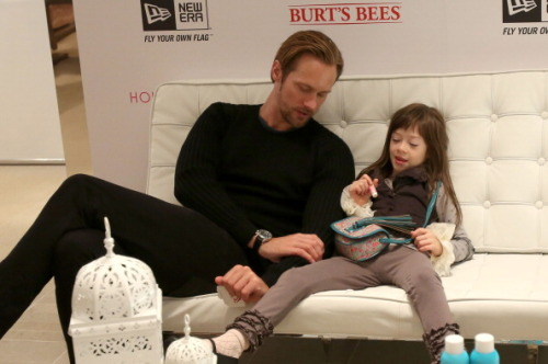 "Alexander Skarsgard finds his softer side in 'What Maisie Knew' TORONTO —Alexander Skarsgard's fame is closely tied to his starring turn on HBO's hit show ""True Blood."" But playing the brooding Viking vampire Eric Northman — and such other alpha male roles as Charlie in Rod Lurie's remake of ""Straw Dogs"" or Cmdr. Stone Hopper in this summer's water-logged action movie ""Battleship"" — has left the actor eager to explore other types of characters. Along came ""What Maisie Knew,"" from directors Scott McGehee and David Siegel, a modern-set adaptation of the Henry James novella centering on 6-year old Maisie and her understanding of her parents' messy custody battle. The movie offered Skarsgard, 36, the chance to shed his steely vampire shell and portray a very paternal caregiver to Maisie (newcomer Onata Aprile). The role of Lincoln the bartender was just what Skarsgard was looking for: vulnerable, quiet, nurturing. What he wasn't expecting was the formidable talent he was up against in Aprile. ""It didn't matter how good all the other actors were,"" said Skarsgard, who costars along with Julianne Moore, Steve Coogan and Joanna Vanderham. ""If we didn't have an amazing Maise — if you don't watch the movie and fall in love with her — then the movie doesn't work."" Millennium Films just scooped up the U.S. distribution rights to the movie after it premiered at the Toronto International Film Festival over the weekend. Skarsgard made a surprise appearance at the premiere, watching the film with Aprile, whom he hadn't seen in many months. The two actors clearly developed a connection both on and off screen and they sat next to each other for the screening, which he described as ""watching home movies, only Onata is the size of Godzilla."" ""It's so wonderful to work with someone like that — once you get over that she's better than you are,"" joked Skarsgard during an interview. The actor was clad in customary black jeans and black T-shirt; Aprile played with a gold balloon nearby. ""She's not self-conscious, whereas we actors try hard to fake it and she doesn't even have to try. It's frustrating. She doesn't deserve it,"" he said with a laugh. Though Skarsgard's parents — actor Stellan Skarsgard and mother My Skarsgard — divorced after 35 years of marriage, it was nothing like what Maisie's character goes through. Skarsgard is the oldest of eight children, six from his mother, two from Stellan's current wife Megan Everett. (The younger children are 3 years old, and 2 weeks old.) ""My parents still hang out, are still best friends and still spend Christmas together. Dad likes to cook every night, so Mom will come over and have dinner with Dad and Megan and all the kids,"" said Skarsgard. ""It's much less dramatic than 'What Maisie Knew.' It wouldn't be a very good movie."" In order to travel to the festival, Skarsgard took a quick break from the Vancouver set of Warner Bros.' thriller ""Hidden,"" where he's playing another intense role, a character living in a fallout shelter. And his other upcoming movies see him in equally serious mode: He's an ex-Marine with post-traumatic stress disorder in the ensemble drama ""Disconnect"" and an angry eco-anarchist out to attack corporations in the indie ""The East"" opposite Ellen Page. ""I need to find something with Danny McBride or Will Ferrell, something like that,"" Skarsgard said. ""I need a comedy. I need something fun."" (someone plz make happen)  http://www.latimes.com/entertainment/movies/moviesnow/la-et-mn-alexander-skarsgard-seeks-out-his-softer-side-in-what-maisie-knew-20120912,0,7649129.story"