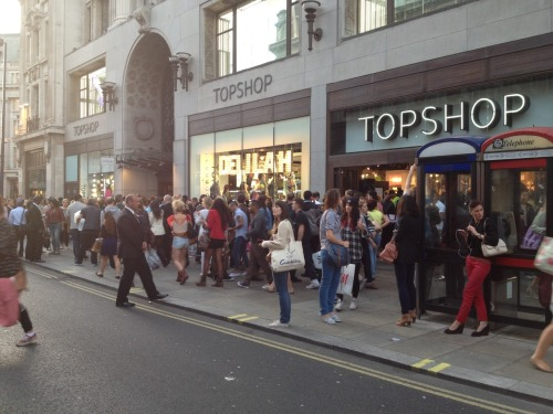 The Topshop Hype. Topshop, the acceptable Primark. There are many obvious perks to high street shopping, with its fast turnover, affordable price tags, imitation designer, and trend orientated stock… However it saddens me personally that it is not a well known piece of information that the majority of the designs and stock had a history and origin before it graced the mass market, often the sources of inspiration are derived from subcultures, emerging designers, or even high end designers. Empirically this is a factor of the fashion industry, yet nevertheless it still shows how readily people will buy into something when presented and advertised perfectly as a mollified form of which it once began: as the product of someone's bright idea.  Recently I went to central London for the Vogue Fashion night out event to see what it consisted of (and of course pick up some freebies along the way) stupidly deciding to get off at Oxford Circus. I was amazed it seemed the majority of the public (well.. aged 12- 30ish anyway) out for the Vogue night seemed to congregate around Topshop, as if unaware other stores were also participating. . Perhaps it was the club vibe it was attempting to uphold with the hench road side security men and metal caging i can only assume intended to keep crazed shoppers at bay.. to me it all just seemed a little melodramatic. Adding to the Topshop Hype. The corollary competition that is the fashion industry is an inevitable positive and negative, however my point is why are people so ready to jump on the Topshop band wagon… You can pretty much window shop just walking down the street.. more often that not you will pass people wearing something or everything from Topshop.. or one of the other high street biggies.. Do you want to be a personified lookbook? Personally I would hate to glorify the high street's ability to rip off talent whether established or not.. through making ever so slight changes and calling it 'new in'. Subcultures are soon to become a rarity as their trademark and representation of the self, are watered down to feed the mainstream's desire to be 'up to date' and 'on trend'. Eventually everyone will end up looking the same. What a boring place that shall be.. No??