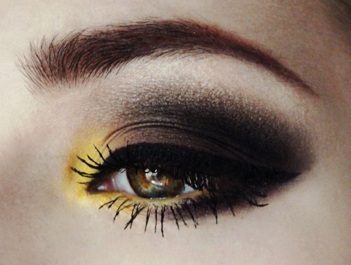 beautylish:  A a pop of yellow to a dark smoky eye like Nicole F.!