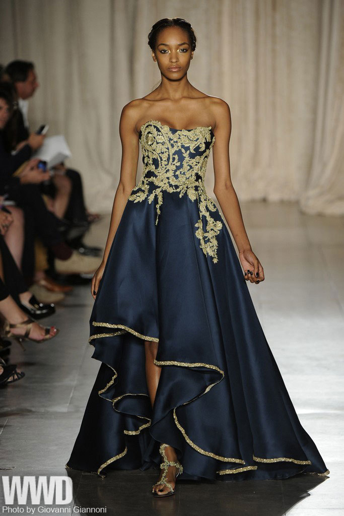 womensweardaily:  Marchesa RTW Spring 2013 Many of the pieces were exquisite, including a languid, white draped gown worn with gold-embroidered illusion tights.  For More See all of WWD.com's RTW Spring 2013 Runway Coverage