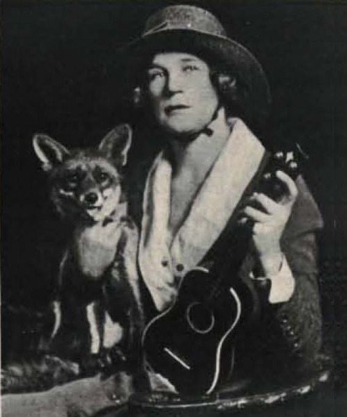 uketeecee:  The woman with the fox and the ukulele Miss Lois Fox was a versatile entertainer from the South. Her captivating Hawaiian music and ukulele made her a favorite wherever she went.During the great war she entertained the troops but before sailing, she tried out a great many ukuleles in order to find the one best suited for her strenuous tour. She selected the Ditson Hawaiian Professional Model No. 3 as being the best instrument and capable of producing the most powerful and sonorous tone. Ditson ukuleles were made by Martin but had a Ditson stamp. The soldiers she met on tour gave her a fox as a pet because of her name. She named the fox 'Nappy-Jo' and took it back the USA at the end of the tour. When she returned, Lois Fox and her Ditson ukulele were much in demand among many clubs and societies. The original foxy lady? (Photo circa 1920)  Important Ukulele Fox.