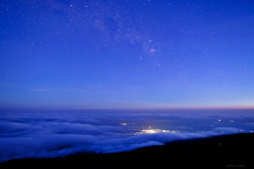 Tanzania Twilight  From high altitude slopes of Mount Kilimanjaro, the highest mountain in Africa, the beginning of a night is photographed over the lights of Moshi, a town situated on the lower southern slopes of Kilimanjaro, Tanzania. The Milky Way has just became visible in the evening twilight.