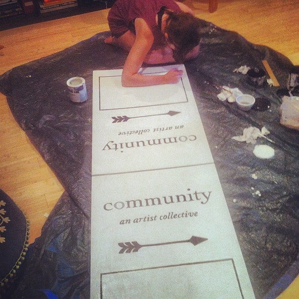 Amanda hand painting the community sign.  @communitycollective  (Taken with Instagram)