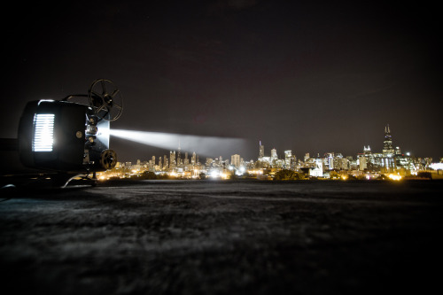 The City Projector… I went up to my roof with an 8mm projector and some Gold Bond Powder and ended up with what you see above. Not bad for a first try but it was windy as hell and Gold Bond was going every where. I plan on giving it another try on a less windy night.