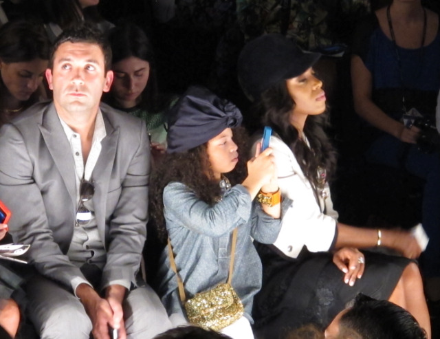 "Cool Kids in the Front Row Sitting at Rebecca Minkoff's show this past week, I looked across the floor only to notice this hip kid rocking a turban while diligently snapping each dress on her iPhone. Make no mistake, she was focused. Sitting beside her was stylist mother, June Ambrose,  who's worked with names from Alicia Keys to P Diddy. June, who refers to Summer as her ""mini-me"", trekked around Fashion Week with the partner-in-crime. In fact, Summer inspires June so much that she named her Selima Capsule Collection frame after her. Careful raising your child with such exquisite taste though. ""She jacked my Marni for H&M pieces as soon as they hit the door"" says June. We suspect June has plenty of clothes to give up.  (Photo and Text: Jauretsi)"