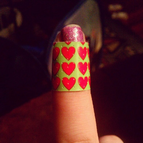 Ouch. #bandaid #hearts #green #pink #chippedpolish #purple #glitter #finger #nailpolish #instalike #instahub #instagood  (Taken with Instagram)