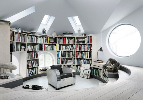 bookshelfporn:  Bookshelf wall in a round studio loft located in Stockholm