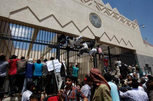 "Sanaa, Yemen: Protesters climb the gate of the U.S. Embassy during a demonstration against  a film ridiculing Islam's Prophet Muhammad, Sept. 13, 2012. Hundreds gathered in front of the US Embassy in Sanaa to protest against the Islamophobic American film ""The Innocence of Muslims."" One protester was killed by police."