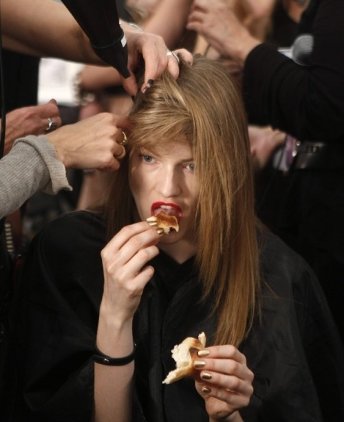14 Fashion Week Food Trends  It's a weird model thing where you open wide, stick your tongue out, place the substance on your tongue, and lap it up like a dog. Maybe it has something to do with not leaving lipstick marks, or maybe it's a diet secret!!!