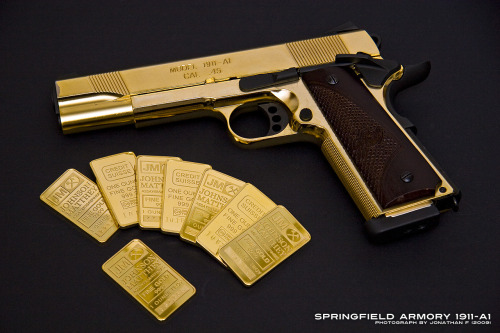 Gilded Springfield Armoury M1911. Found on the Redfire Motion Group flickr.