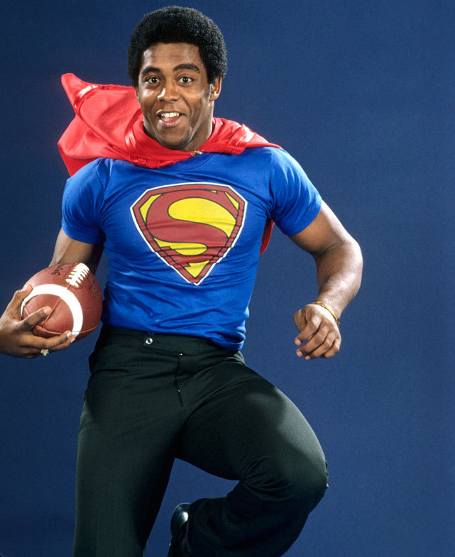 It's a bird! It's a plane! It's Tony Dorsett! The Pitt running back, pictured here during a Nov. 1976 SI photo shoot, would go onto win the Heisman Trophy after gaining 2,021 yards from scrimmage to go along with 22 touchdowns. Dorsett would be picked by Dallas with the second overall pick a few months later. (Manny Millan/SI) GALLERY: Athletes In Their College Dorm