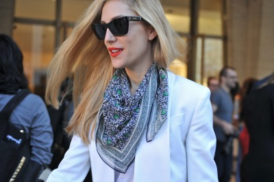 It's all in the mix – Editor Joanna Hillman offsets her white blazer with a vibrant orange pout #NYFW