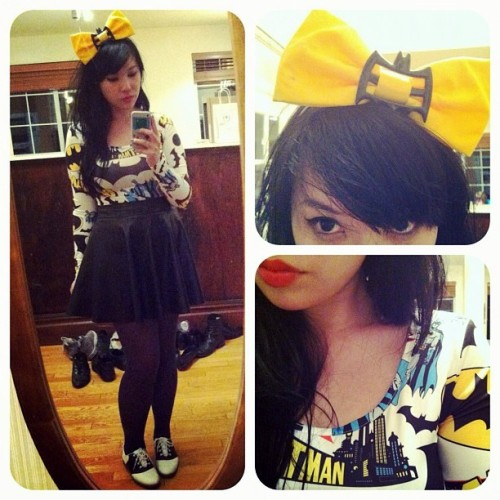 bettyfelon:    09.12.12 outfit - Batty B yellow Bat bow: handmade/Betty FelonBatman bodycon dress: Lazy Oaf (via asos)black skirt: Forever 21Batman mask ring: eBaygrey tights: Dorothy's Boutiquesaddle shoes: Payless    I'm currently on vacation in California this week, but here's a quick outfit shot from my adventures yesterday~ We also stopped by the Cartoon Art Museum, which currently has an amazing Avengers exhibit!