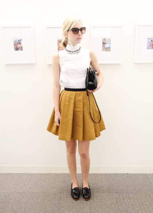 For the last day of NYFW, Jane Keltner de Valle wears a Proenza Schouler top, Fenton/Fallon necklace, Prada sunglasses, Jason Wu skirt, bag and shoes