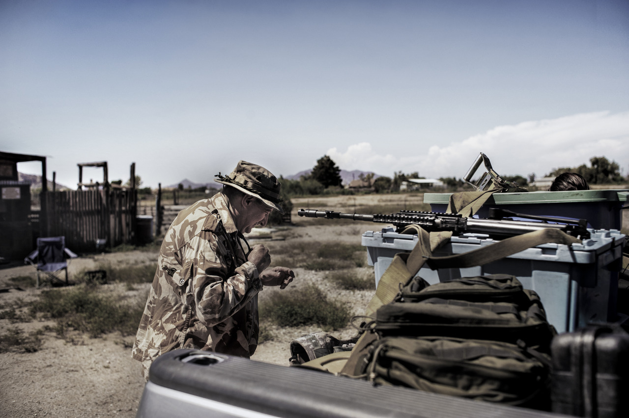 "AUGUST 2012- SOUTHERN ARIZONA- Members of the NSM have been patrolling the Mexican/US Border since 2010 and since then, various groups around the southern United States have ""volunteered"" their time and efforts to patrol the border.  Although the official border patrol operations are assigned to the United States Border Patrol, the United States Border Guard (no relation) absorbs an equal amount of participation in these operations.  Albeit they operate separately, and under no support by the government, the USBG and its operations are technically legal, however thin of a line it may be.   Following the controversiald quadruple murder/suicide of its original chief organize, JT Ready, also former NSM member, the USBG's operations have since continued.  Photo Credit Johnny Milano/Sipa USA"