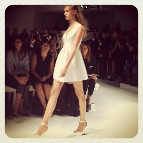 Pure white mini dress at Calvin Klein Photographed by Gloria Baume