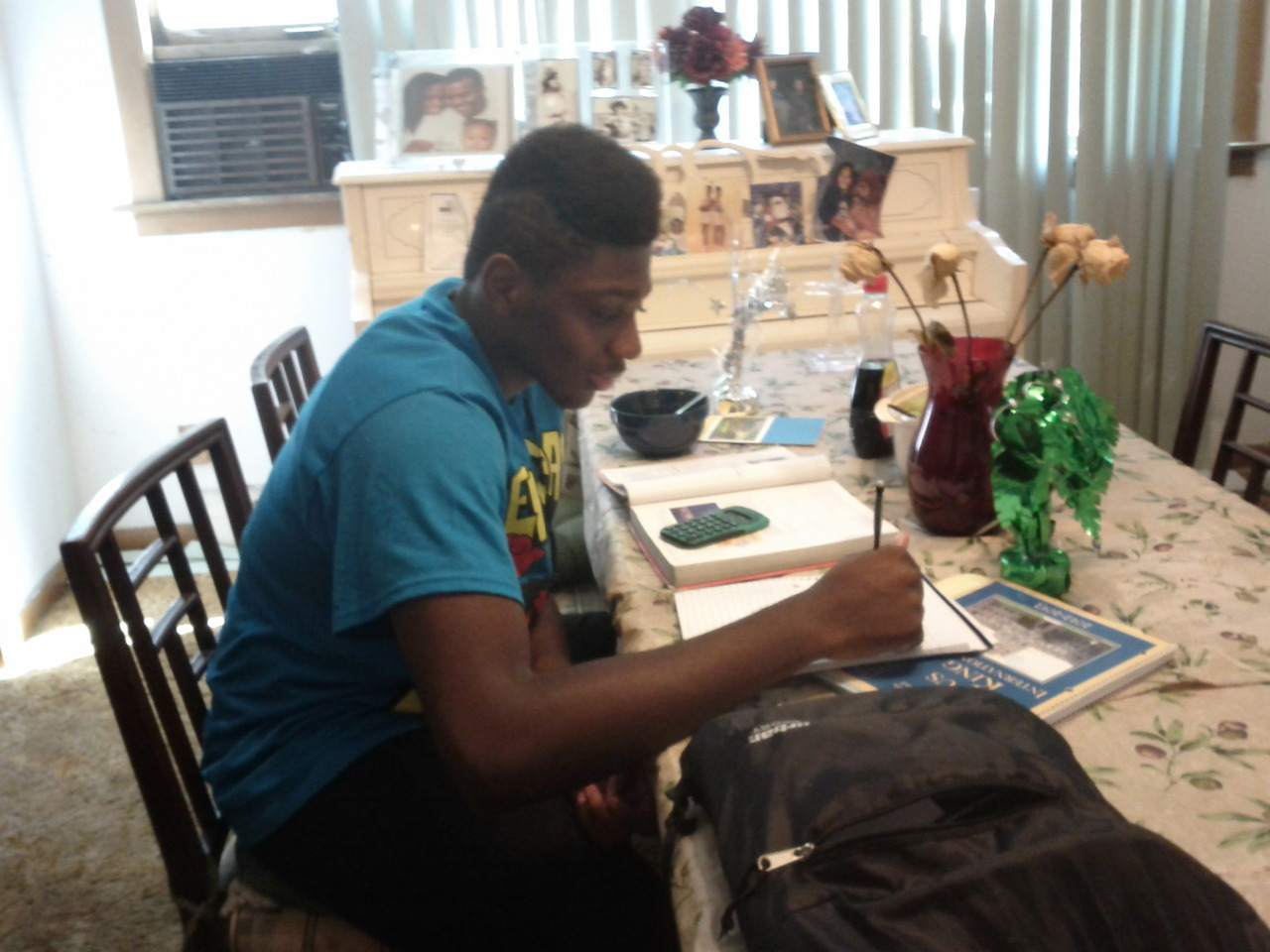 Samuel Asante Morrow (9th Grade) Rufus King Samuel Studying for Success