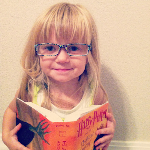 thegirlwiththepaperbackbook:  What attracts me to books is that no matter what's going on, I can pick up a book and instantly be transported far past my fears. I'm may be broke, and stressed, but I can find comfort in pages and they get me through.  I love this picture, and caption. Moreover, she's reading my favorite book!