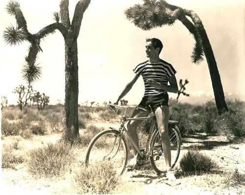 Tyrone Power rides a bike. And smokes a cigarette.