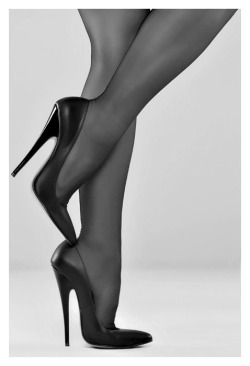 "fabulouslyfetish:  steinerkd:  Classy and hot!  These are Fabulously Fetish Kiara 6.5"" heels, worn by Ruby True and photograph by The Phnarrcissist. No idea why the photo is now black and white now, Tumblr is a weird place!    Remarkable image…"