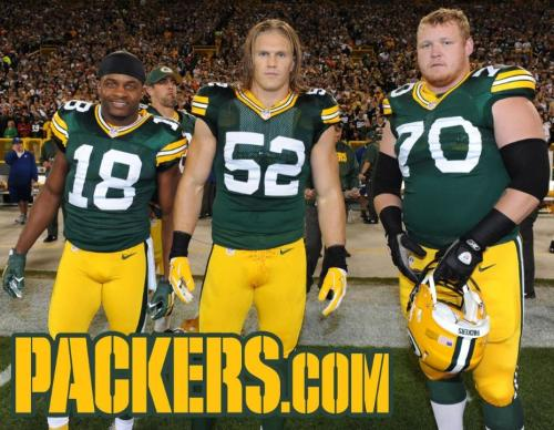 Team Captains Randall Cobb, Clay Matthews, and T. J. Lang (with Aaron Rodgers photo-bombing in the background) on 9/13/12