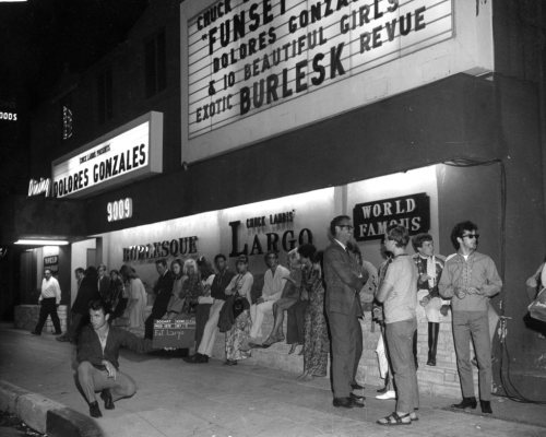 "zombienormal:   Vintage photo of Chuck Landis' LARGO nightclub on Sunset Boulevard in L.A.  The nightclub was being used in the 1969 film entitled: ""Marlowe"", starring James Garner.. With Rita Moreno playing a stripper named: ""Dolores Gonzales"".. This is the same venue where mobster Mickey Cohen used to watch Candy Barr and Beverly Hills perform.."