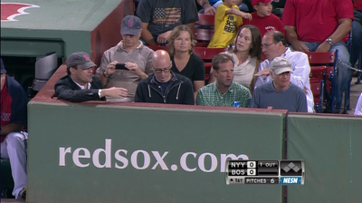 Jon Hamm (far left) and Larry David (far right) take in a Red Sox - Yankees game at Fenway Park Thursday night.